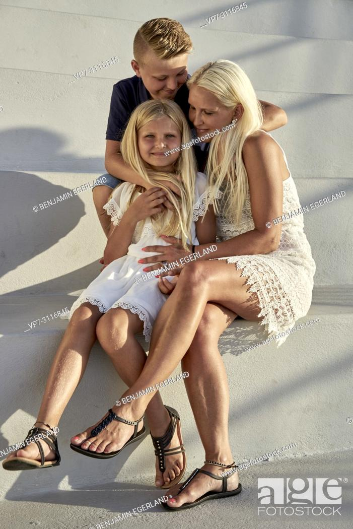 Stock Photo: mother with two children.