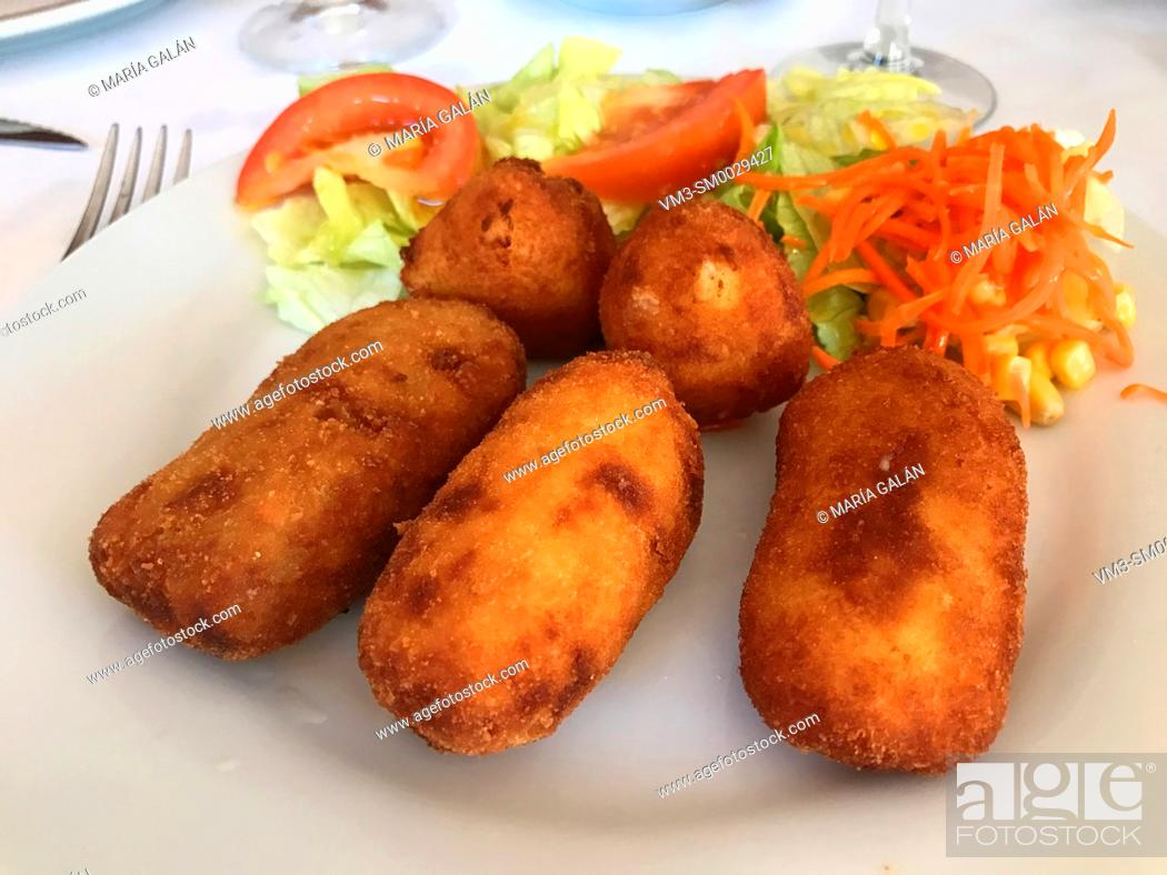 Stock Photo: Croquettes with salad.