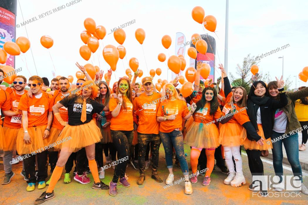 Stock Photo: Aliexpress, celebrating its 9th anniversary with a colorful holi run in Valdebebas, Madrid, Spain. There were more than 6000 participants.