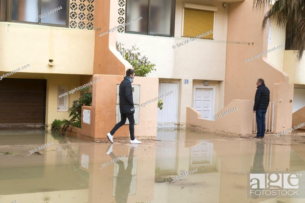 Stock Photo: Tavernes de la Valldigna, Valencia, Spain, January 22, 2020. The streets of the urbanization seem to be rivers due to the flooding of sea water.