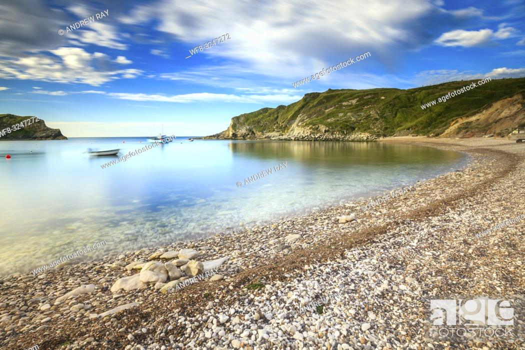 Stock Photo: Lulworth Cove on Dorset's Jurassic Coast, captured on a morning in early July. A long shutter speed was utilised to blur the movement in the clouds and water.