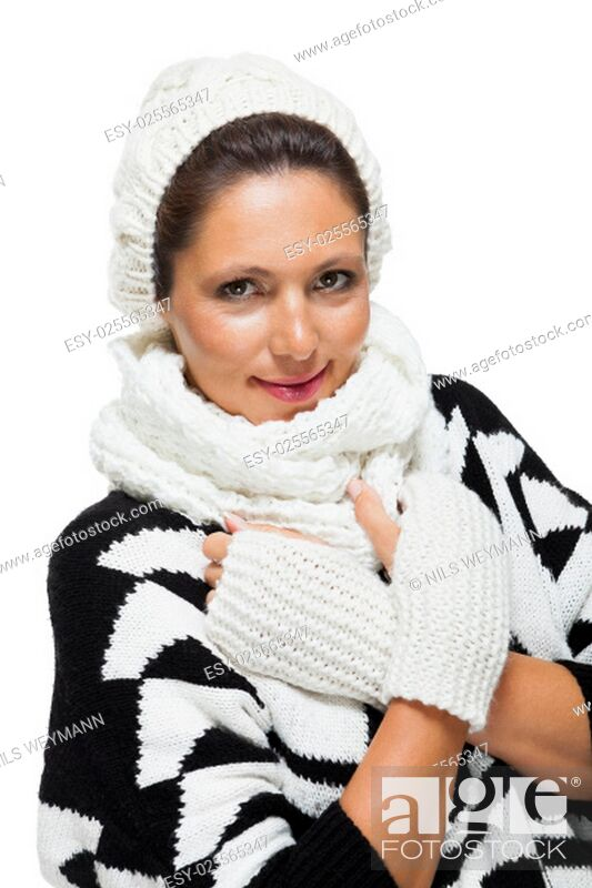 Stock Photo: attractive young woman with white wool hat and scarf knitted sweaters gloves with dark hair laughing isolated on white background.