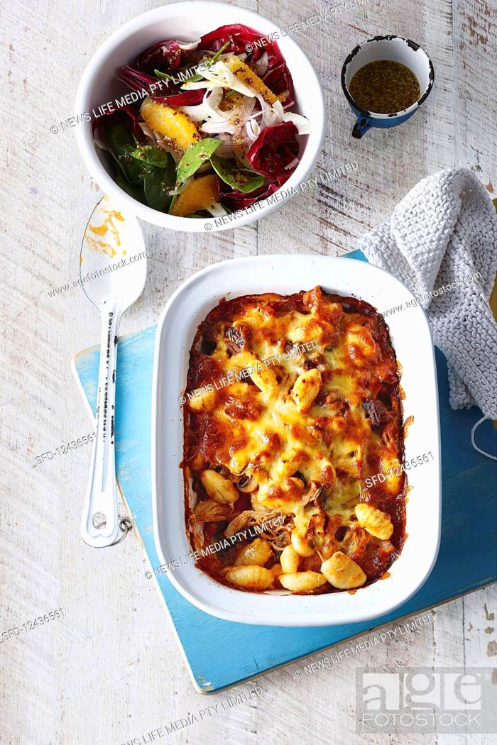 Stock Photo: Gnocchi and chicken gratin with a cheese crust and winter vegetable salad.