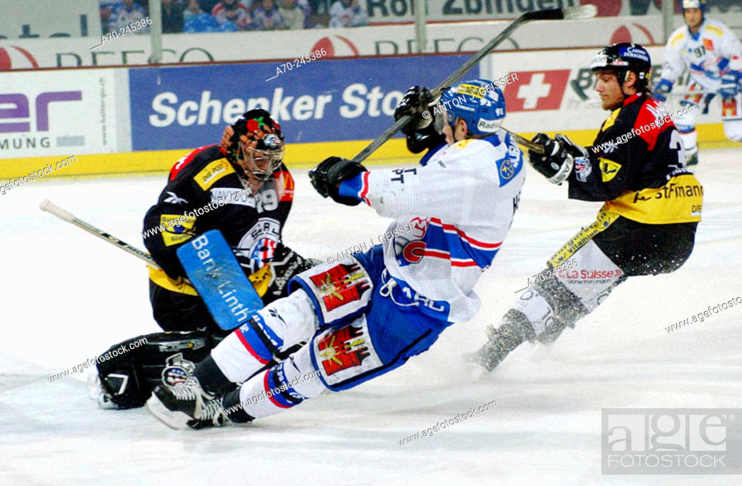 Stock Photo: Swiss Ice Hockey, SC Rapperswil-Jona vs. ZSC-Lions. Livio Fabio (right), Gian Carlo Hendry (center) and goalkeeper Thomas Berger (left).
