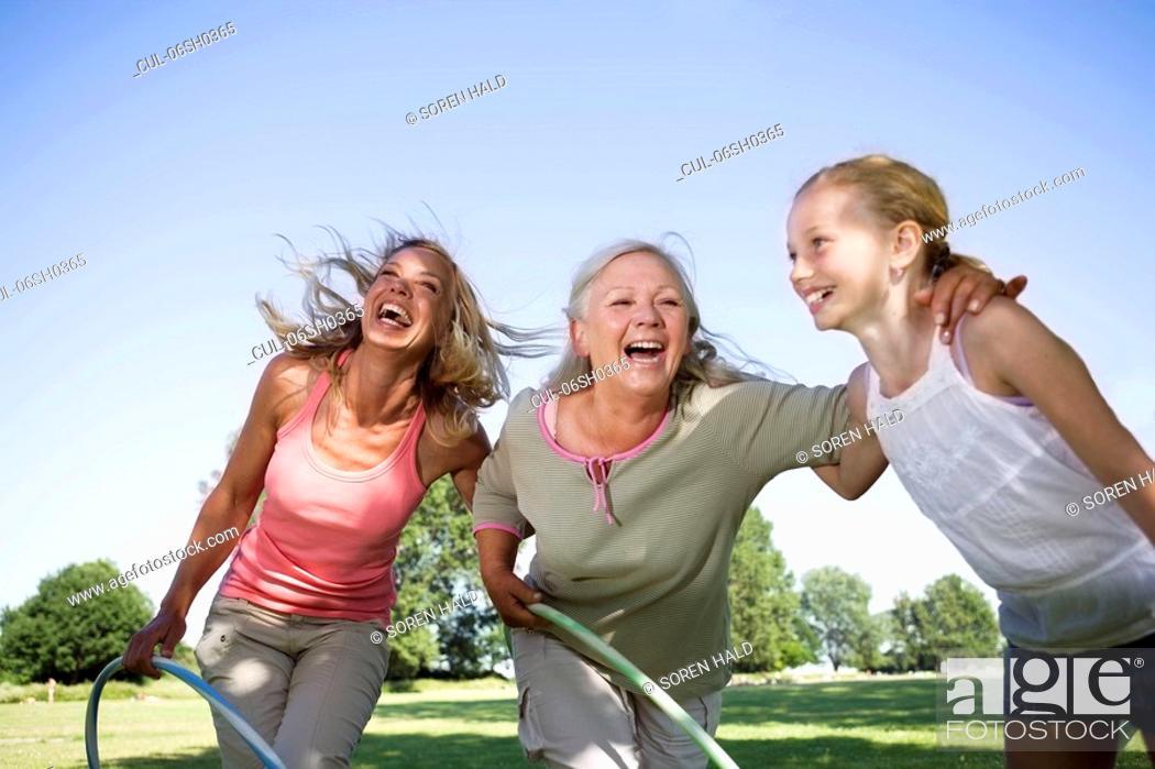 Stock Photo: 3 generation women with hula hops.