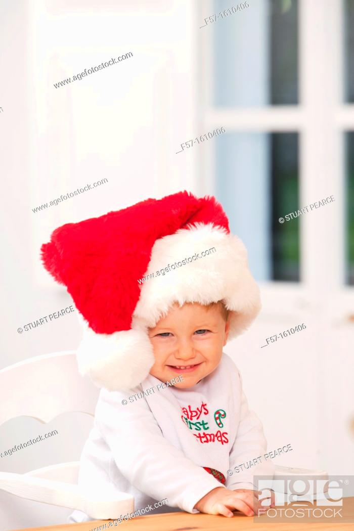 Stock Photo: One year old boy wearing a Santa hat.
