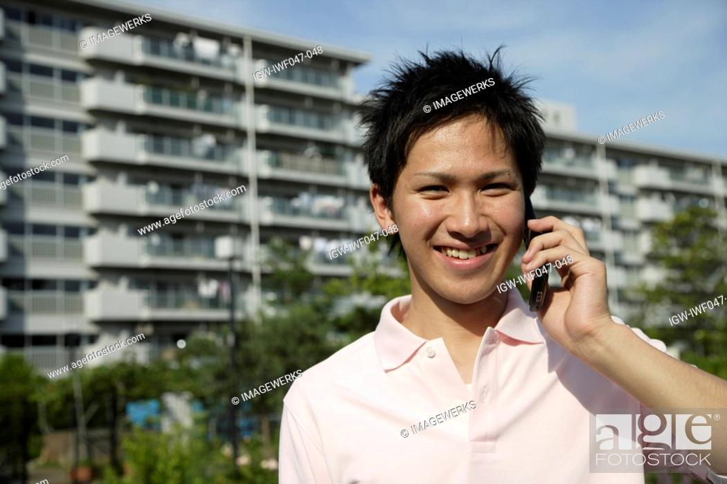 Stock Photo: Portrait of a young man talking on mobile phone.