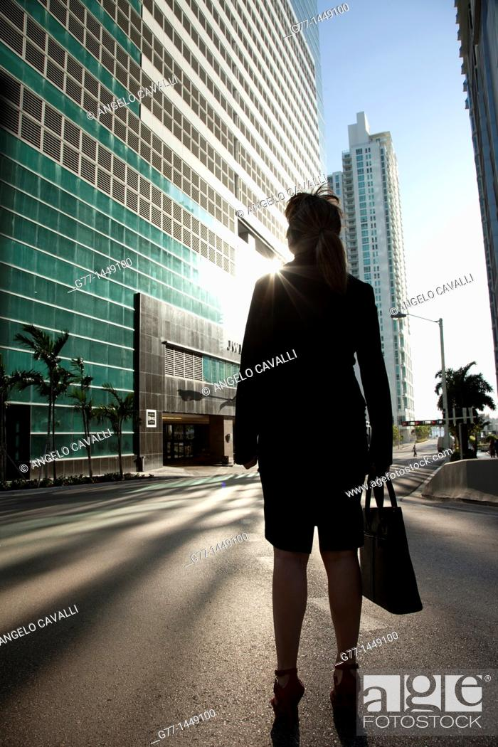 Stock Photo: Business woman in front of building.