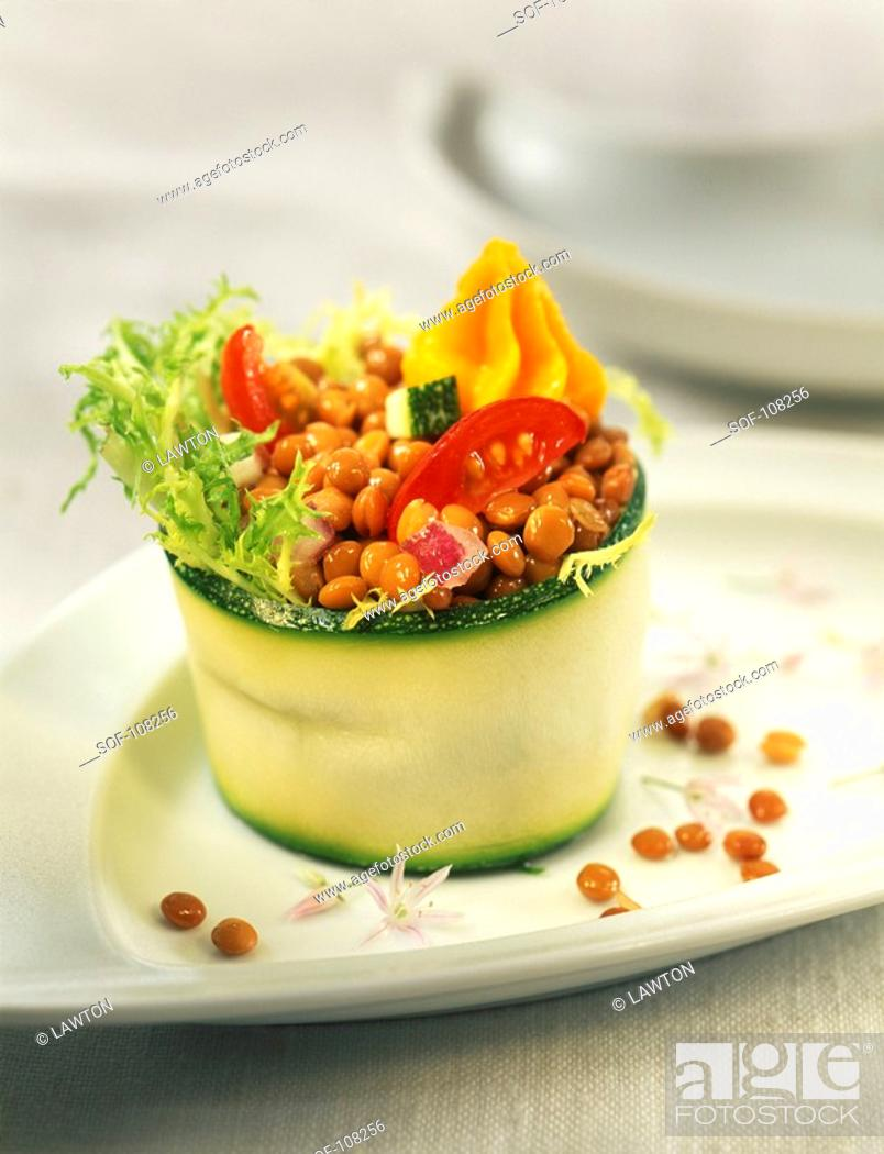 Stock Photo: Rolled courgette filled with lentil salad and sobrasada mousse.