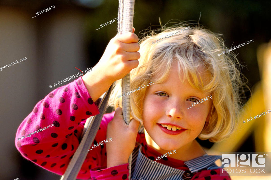 Stock Photo: Girl swings and smiling.
