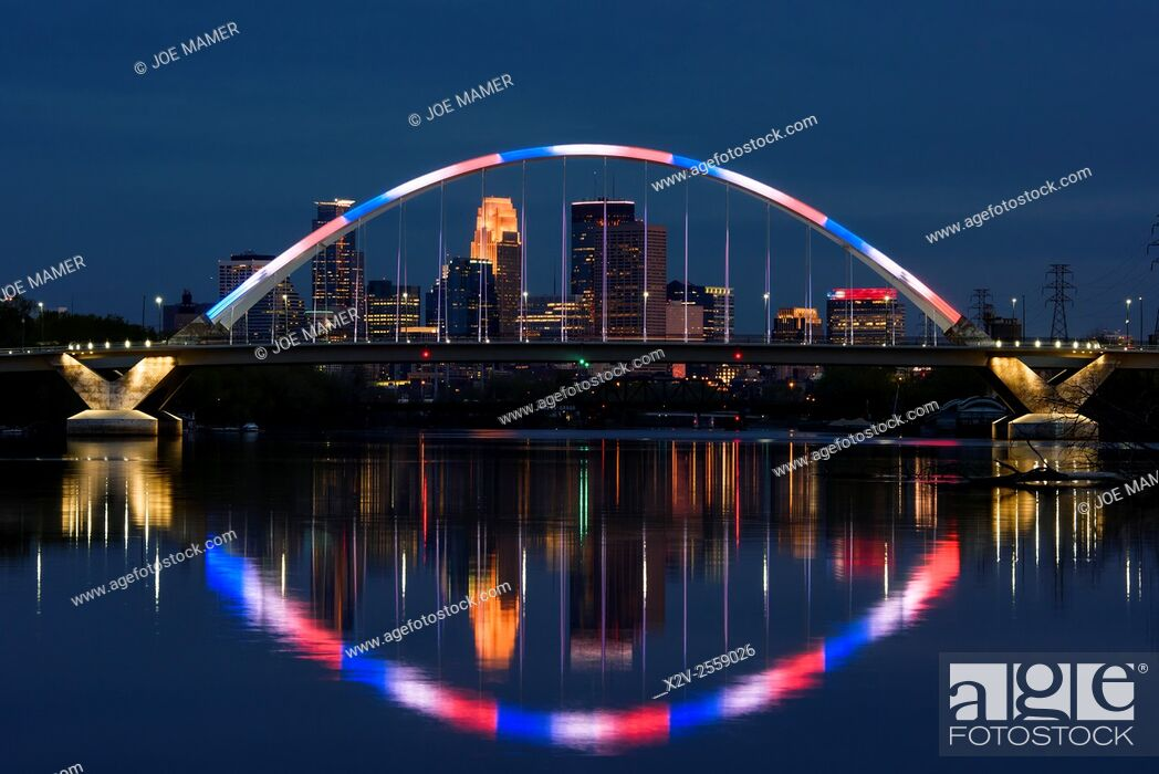 Stock Photo: Lowry Avenue bridge at dusk with blue and red lighting.
