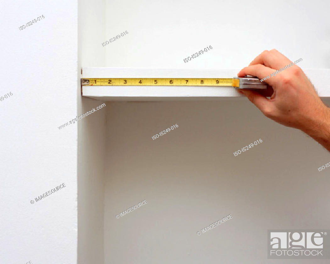 Stock Photo: Measuring shelf length.