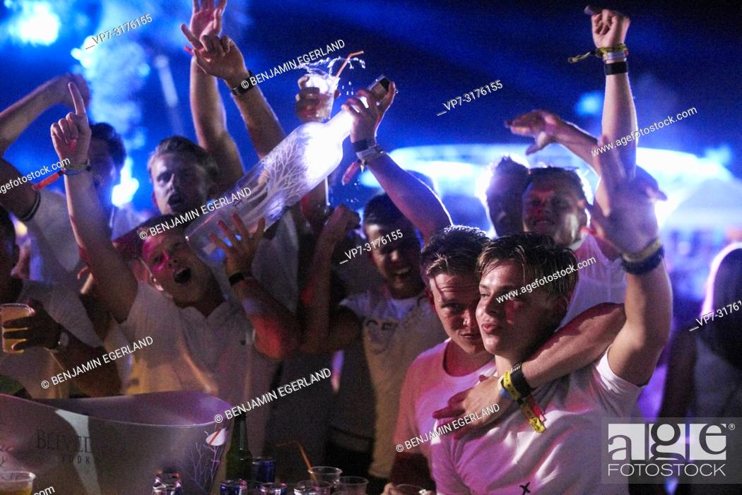 Photo de stock: party people holding Belvedere Vodka bottle at music festival Starbeach Chersonissos, Crete, Greece, at 06. August 2018.