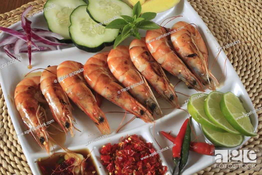 Stock Photo: Grilled prawns, side dishes, food, cuisine, gastronomy, seafood, lime, garlic, peppers; horizontal;.