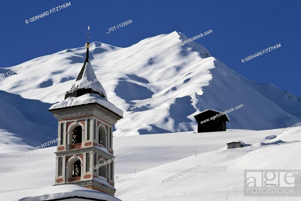 Stock Photo: Church tower and snowy mountain in background.
