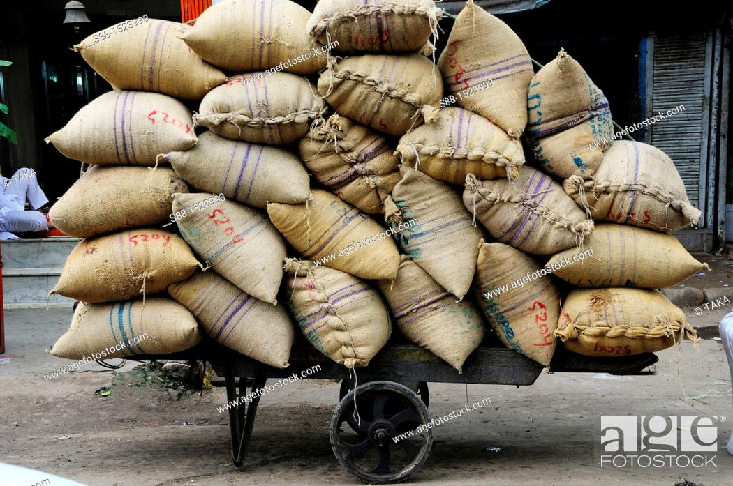 Stock Photo: Sack of grain at Chandni Chowk, Old Delhi.