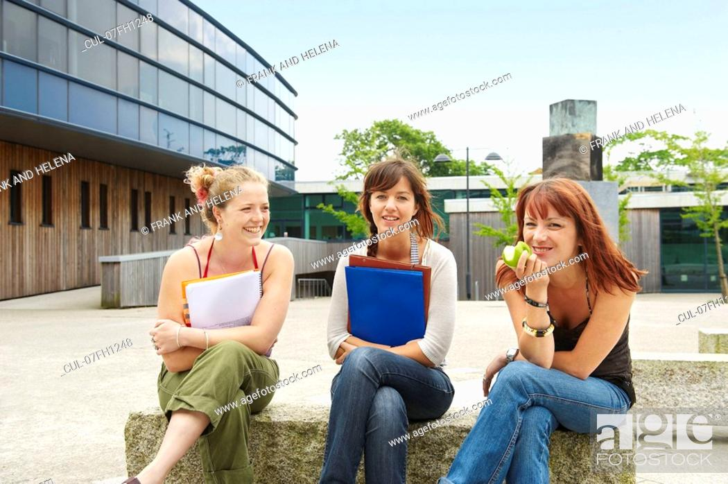 Stock Photo: Three young women on campus.
