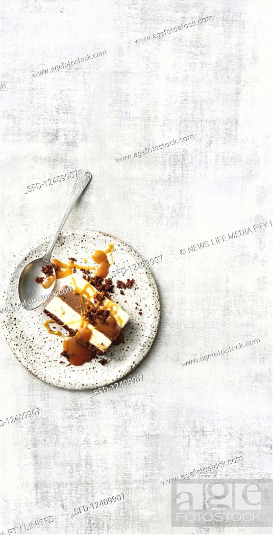 Photo de stock: Chocolate and peanut terrine with caramel sauce.