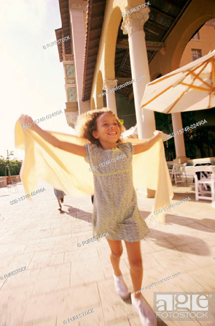 Stock Photo: Front view of a girl running with a shawl.