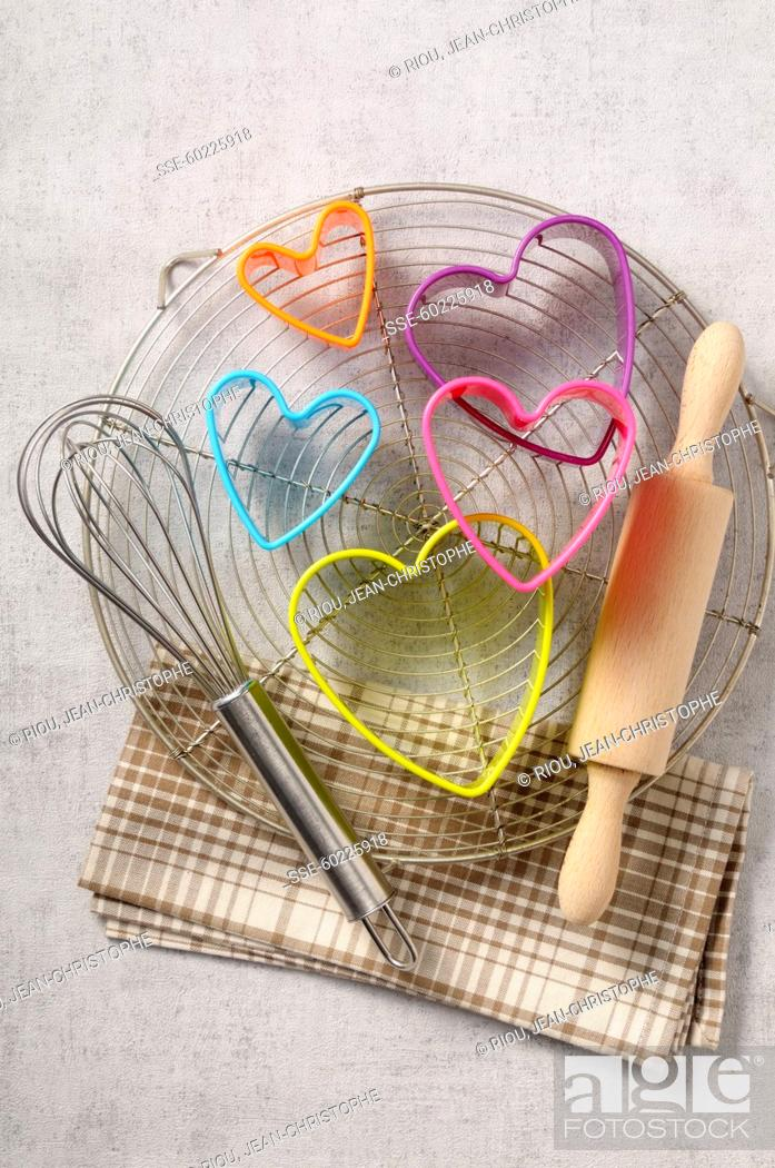 Stock Photo: Multicolored heart-shape biscuit cutters,whisk and rolling pin.
