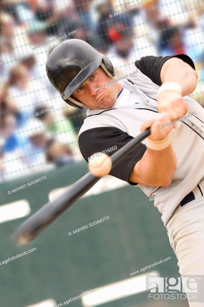 Stock Photo: Baseball player hitting ball.