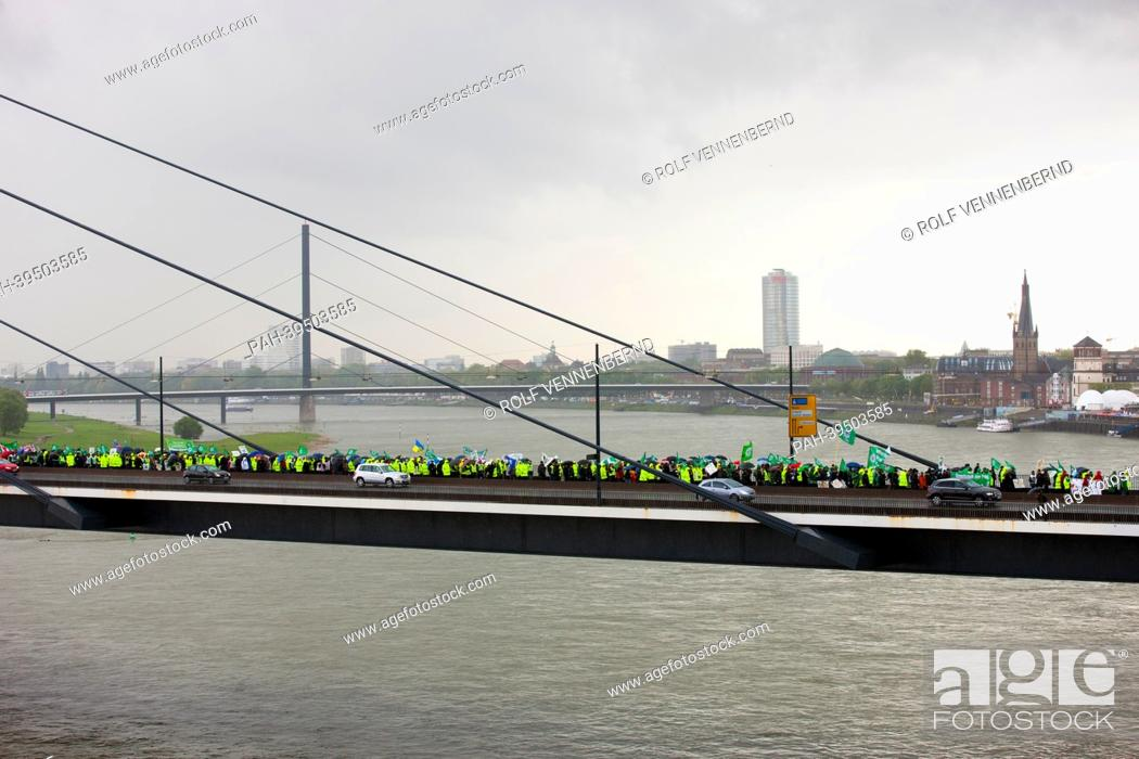 Stock Photo: Civil servants walk over the Rheinknie bridge to the state parliament in Duesseldorf, Germany, 15 May 2013. The protests are directed against planned salary.