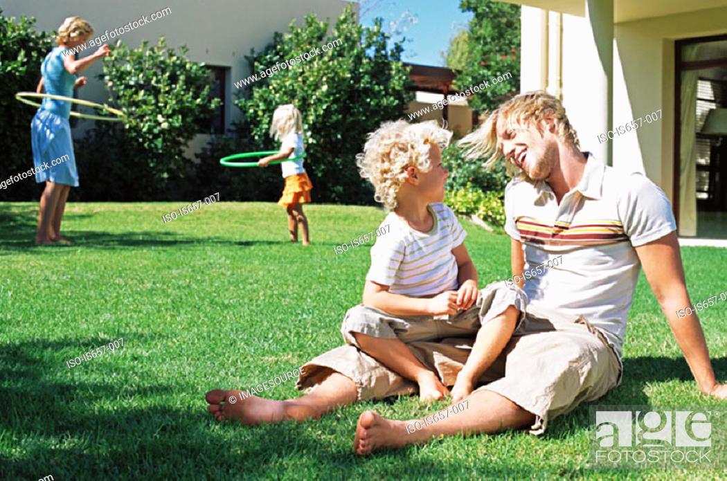 Stock Photo: Family in garden.