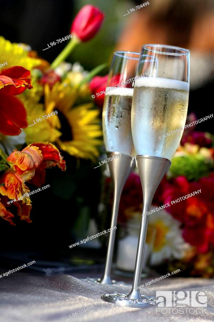 Stock Photo: toasting glasses filled with champagne.