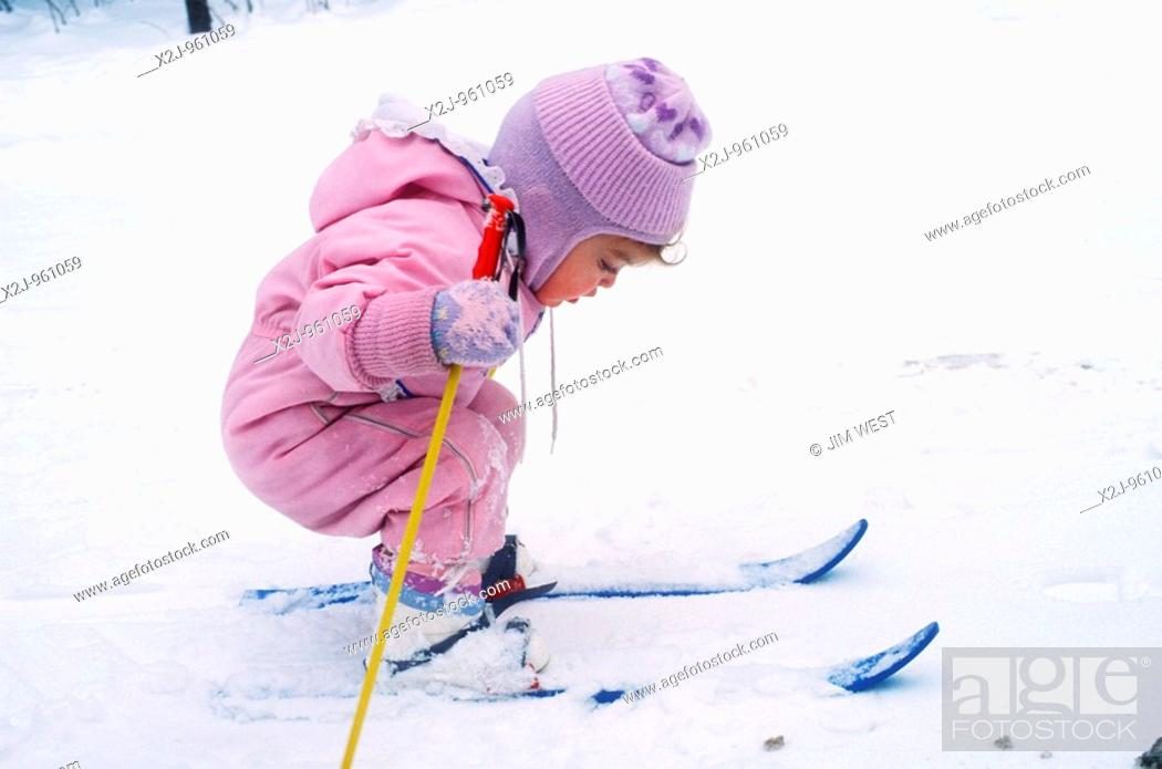 Stock Photo: Charlevoix, Michigan - Mariel West, not quite 2, tries cross-country skiing  MR.