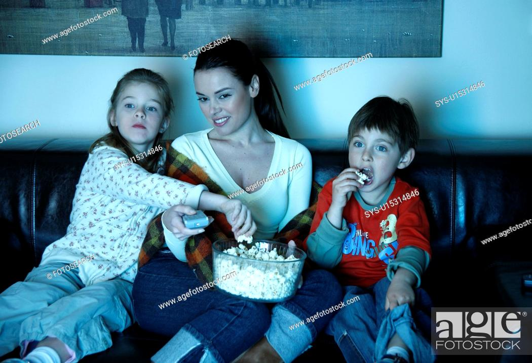 Stock Photo: Mother and children watching television.