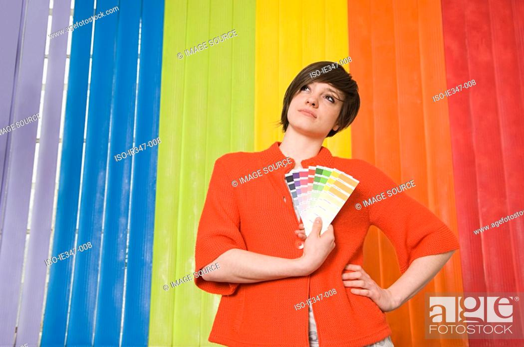 Stock Photo: Young woman with colours.
