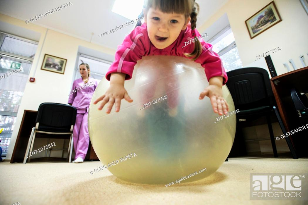 Stock Photo: Orphans play in physiotherapy room, Orphanage 'Zhytomyr regional children home', Ukraine. 2 February 2015. 'Zhytomyr regional children's home' has 67 orphan.