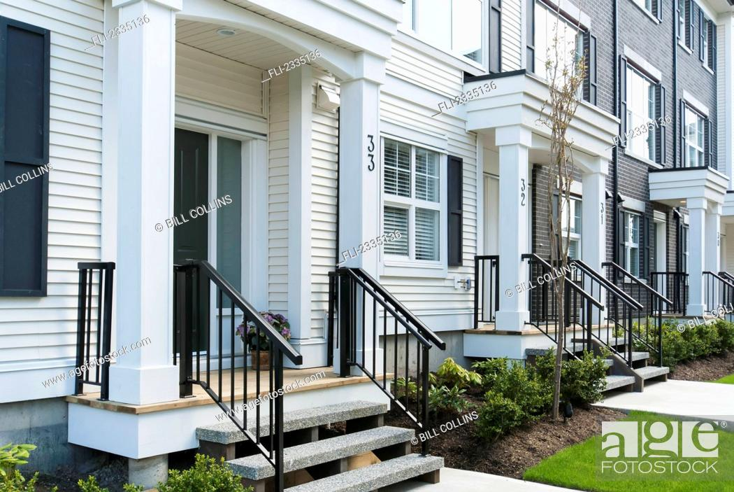 Stock Photo: Modern townhouse row exterior with sidewalks and porches; Surrey, British Columbia, Canada.