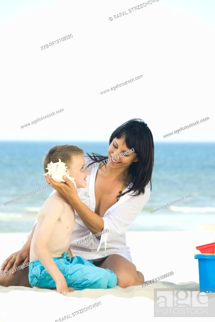 Stock Photo: mother with son playing on beach.