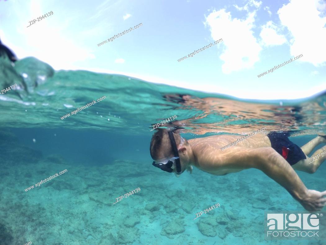 Stock Photo: Young man snorkeling in Formentera island Balearics Spain.