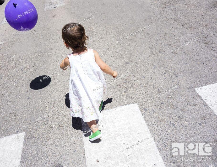 Stock Photo: Little girl running behind a ball. Alboraya, Valencian Community, Spain.