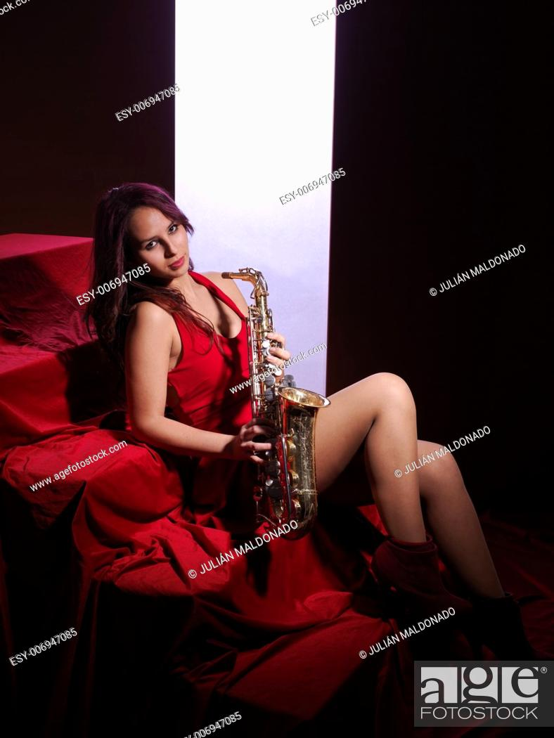 Stock Photo: Sexy young woman with saxophone.