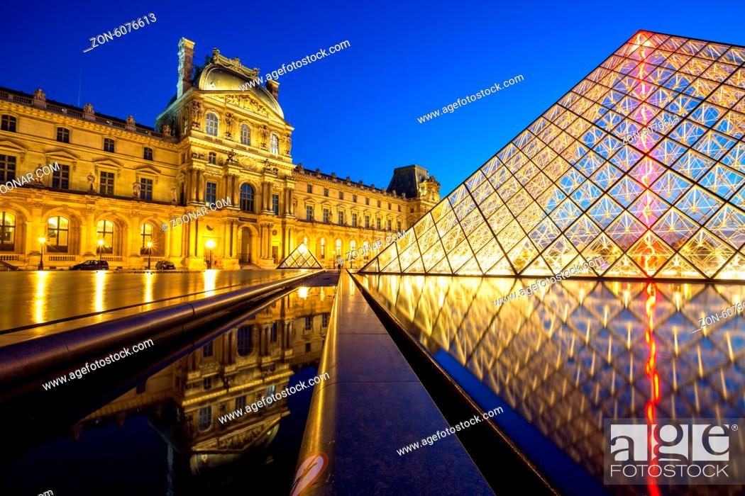 Stock Photo: Paris - June 18: Louvre museum at dusk on June 18, 2014 in Paris. This is one of the most popular tourist destinations in France displayed over 60.