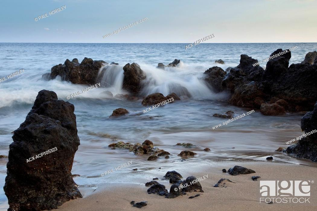 Stock Photo: Waves crashing over lava rock, Maui, Hawaii.