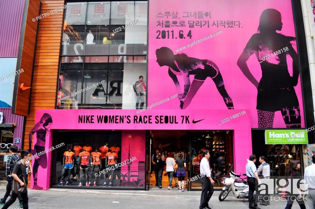Stock Photo: Seoul (South Korea): Nike store in the Myeong-dong shopping district.
