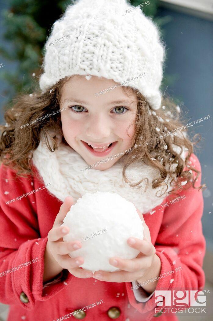 Stock Photo: Czech Republic, Pretty girl (4-5) with snowball.