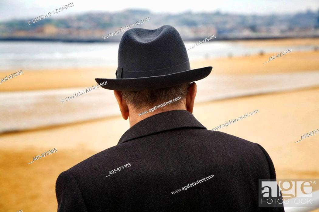 Stock Photo: Senior man with hat at San Lorenzo beach, Gijon, Asturias, Spain.