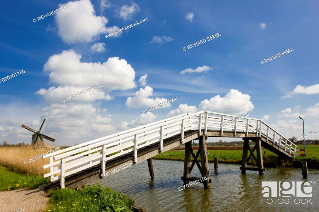 Stock Photo: bridge and windmill, Netherlands.