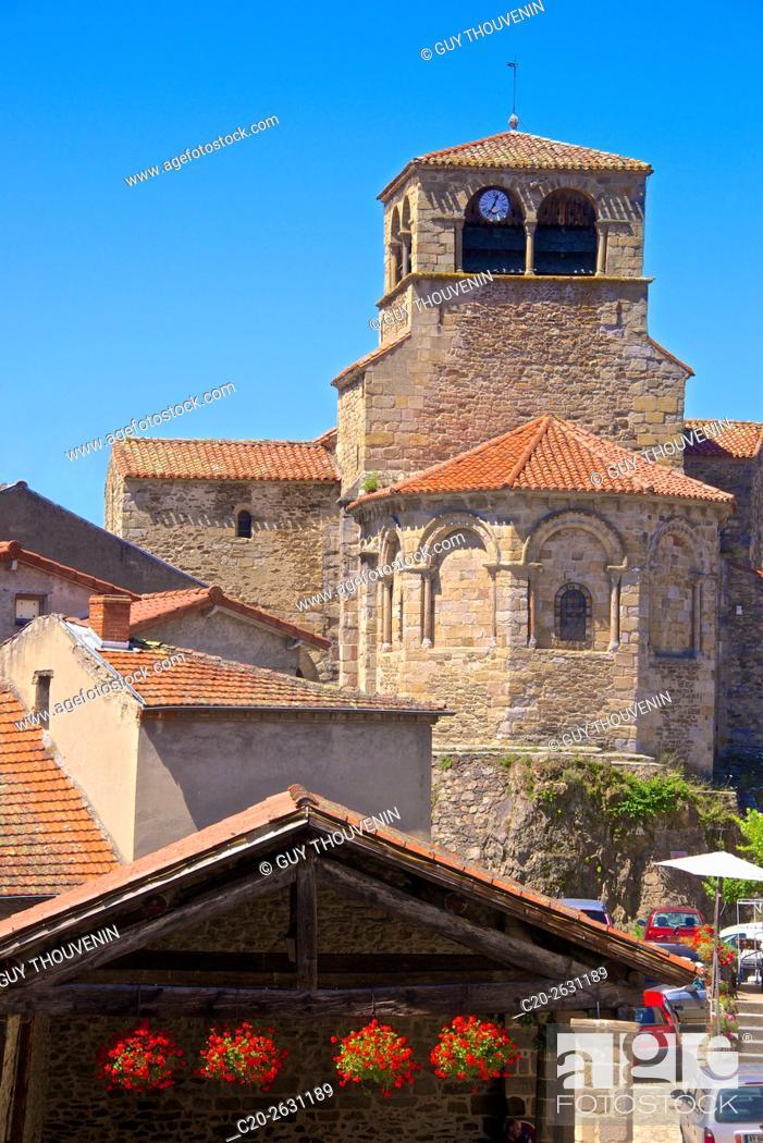 Stock Photo: Saint-Laurent d'Auzon Collegiate church, 12th c. , and village, Auzon, 43, Haute Loire, France.