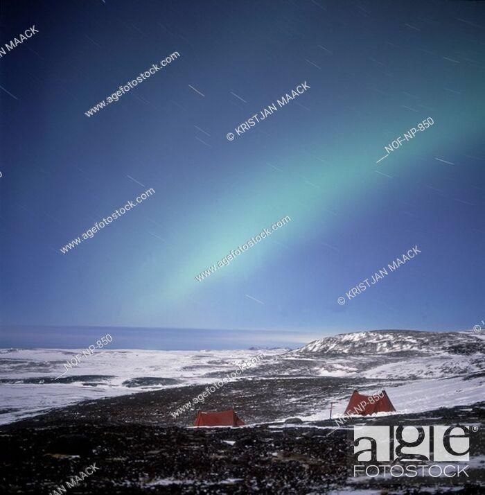 Stock Photo: Northern Lights, snowy landscape beneath.