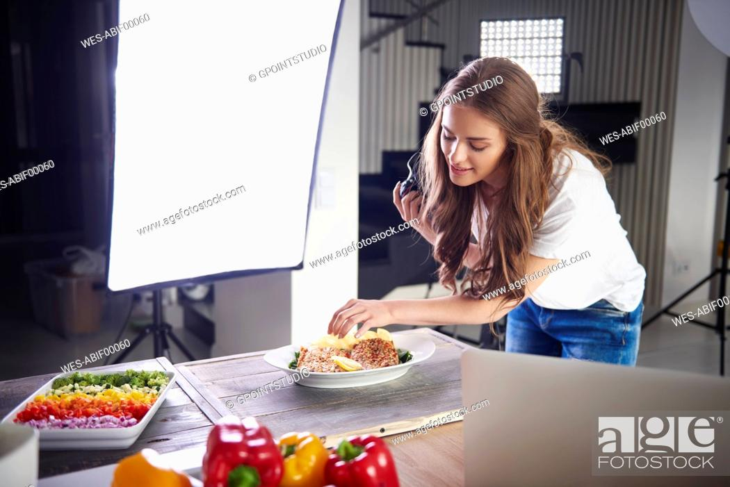 Stock Photo: Blogger arranging food for a photo.