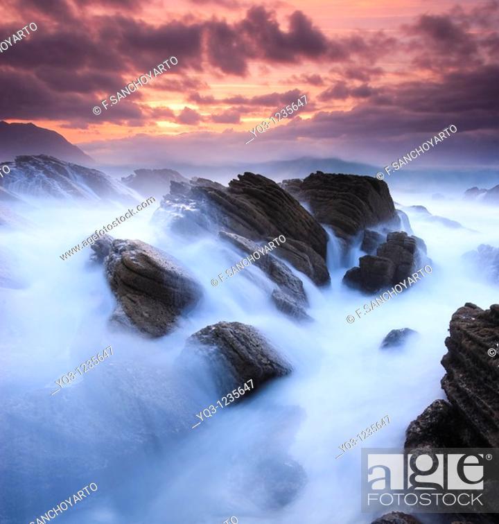 Stock Photo: Waves breaking against the coast in Cerdigo, Castro Urdiales, Cantabria, Spain.