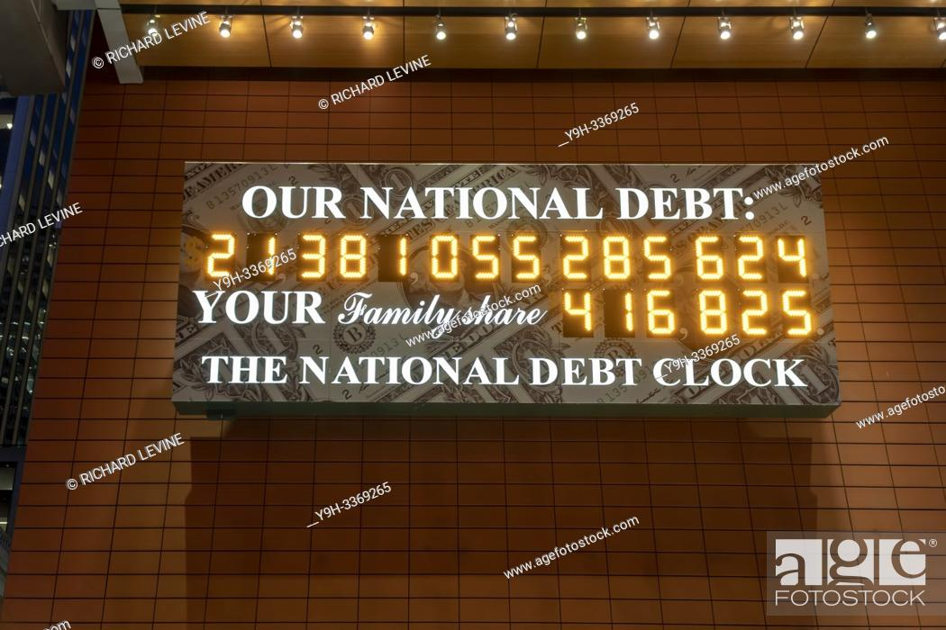 Stock Photo: The National Debt Clock is seen in New York on Wednesday, February 13, 2019. Despite the clock being out of sync, the U. S. Treasury Dept.