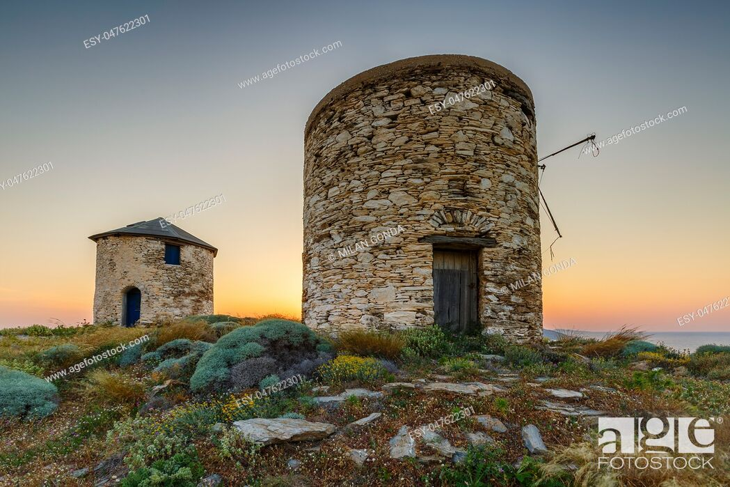 Stock Photo: Old traditional windmills on the main island of Fournoi Korseon in northern Aegean, Greece. .