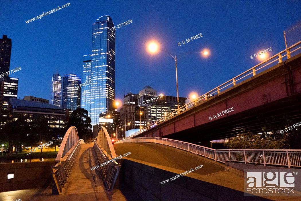Stock Photo: pedestrian bridge and Kings Bridge, with Melbourne city skyline.